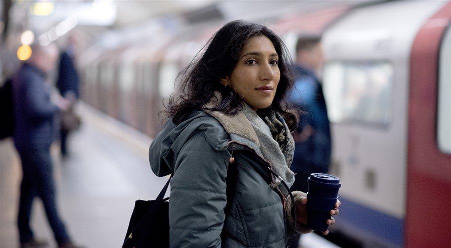 Woman in London Underground on way to work
