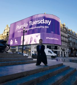 Mike Adams OBE Purple CEO at Piccadilly Lights Purple Tuesday 2018