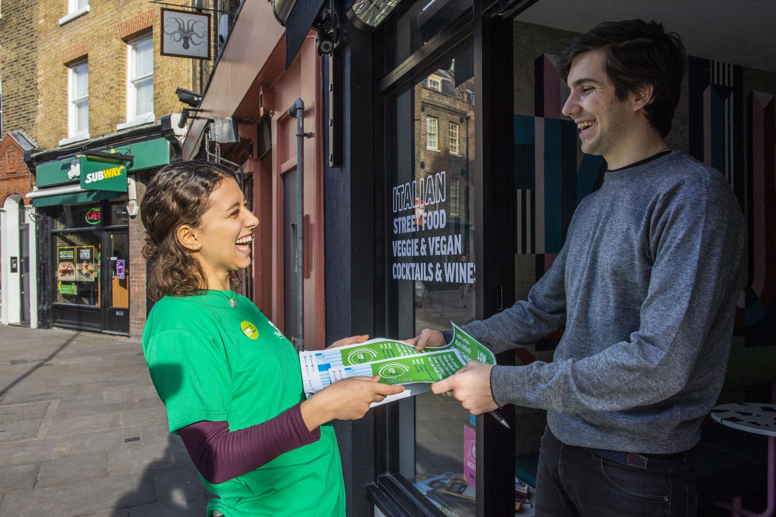 Claire des Pallieres hands out posters to local businesses announcing the launch of LondonÕs first Low Plastic Zone (LPZ)