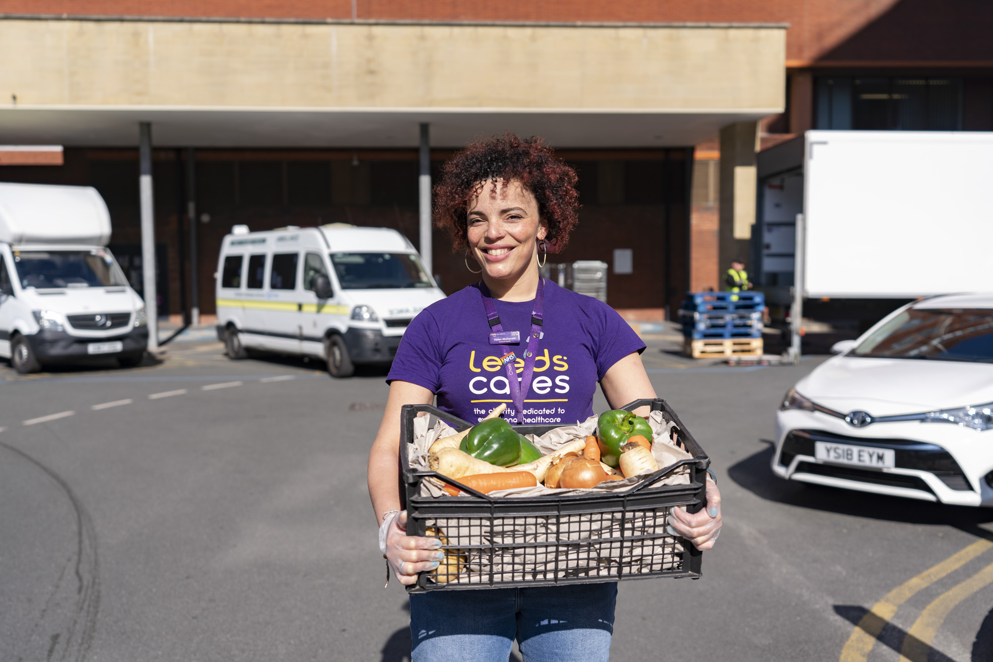 Helen Macdonald from Leeds Cares holds a package of fresh fruit and veg for NHS workers as part of the Feed the Frontline initiative